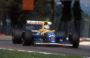 1992 San Marino Grand Prix. Imola, Italy. 15-17 May 1992. Nigel Mansell (Williams FW14B Renault) 1st position. Setting a new record of winning five consecutive Grand Prix from the start of the season. Ref-92 SM 07. World Copyright - LAT Photographic